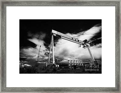 Giant Harland And Wolff Cranes Goliath Amd Samson With Wind Turbine Blades At Shipyard Titanic Framed Print by Joe Fox