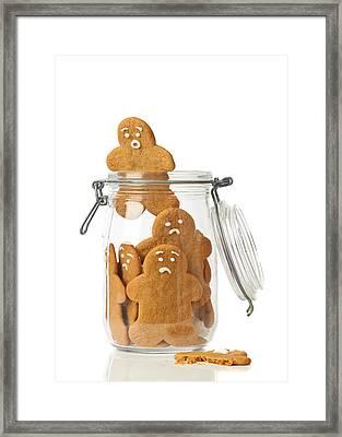 Gingerbread Men Escape Framed Print by Amanda Elwell
