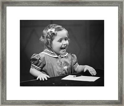 Girl (4-5) Sitting At Table, Smiling, (b&w) Framed Print by George Marks