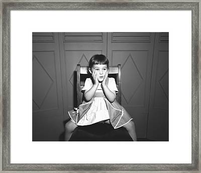 Girl (5-5) Sitting Astride Chair, Making Face, (b&w), Framed Print by George Marks