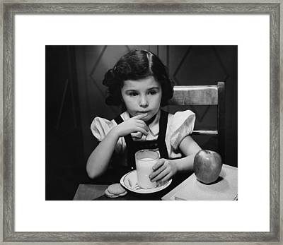 Girl (6-7) Sitting At Table, Having Breakfast, (b&w) Framed Print by George Marks