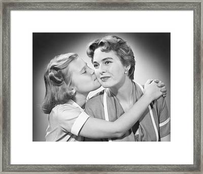 Girl (8-9) Kissing Mother, (b&w) Framed Print