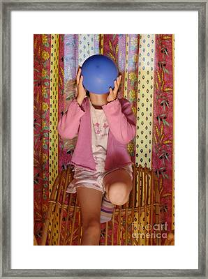Girl Blowing Up Balloon Framed Print by Sami Sarkis