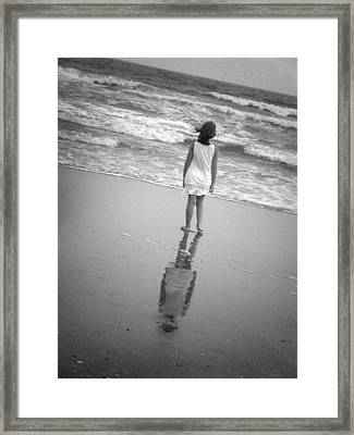 Girl By Ocean Framed Print by Kelly Hazel