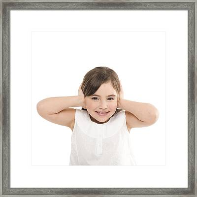 Girl Covering Her Ears Framed Print by