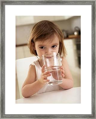 Girl Drinking Water Framed Print by Ian Boddy