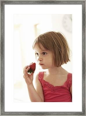 Girl Eating A Strawberry Framed Print