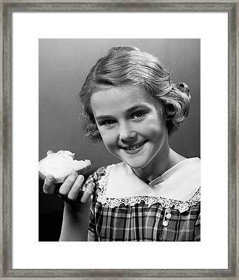 Girl Eating Bread Framed Print by George Marks