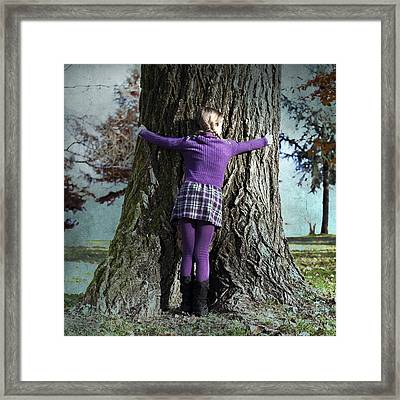 Girl Hugging Tree Trunk Framed Print by Joana Kruse