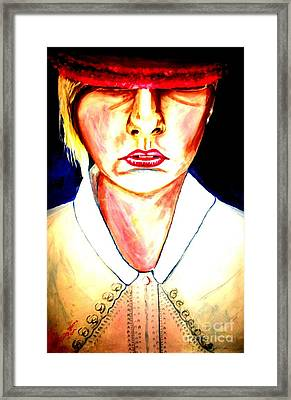 Girl In Hat Moody Red  Framed Print by Judy Morris