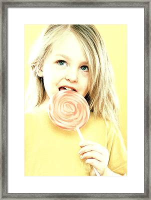 Girl Licking A Lollipop Framed Print by Kevin Curtis