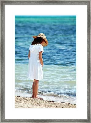 Girl On A Beach Framed Print