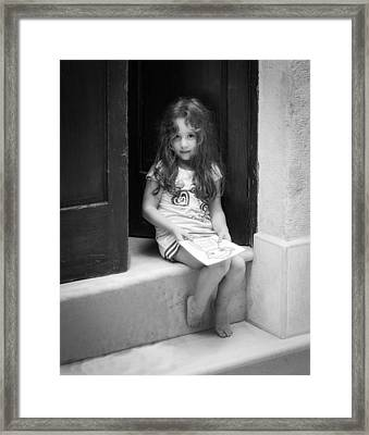 Girl On Doorstep Framed Print