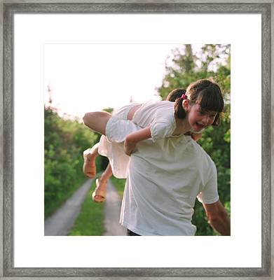 Girl On Fathers Shoulder Framed Print by Michelle Quance