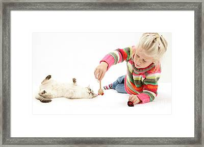 Girl Playing With Cat Framed Print by Mark Taylor