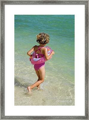Girl Running Into Water On Beach Framed Print by Sami Sarkis
