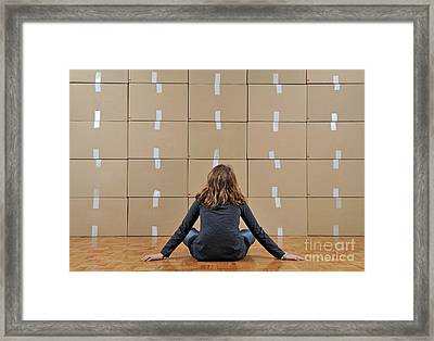Girl Seated In Front Of Cardboard Boxes Framed Print by Sami Sarkis