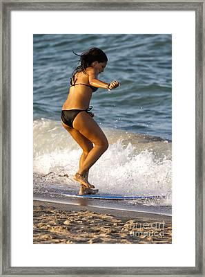 Girl Skimming On The Ocean Framed Print