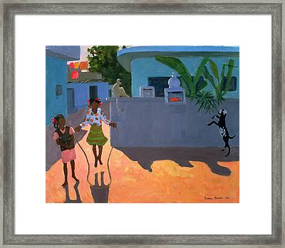 Girl Skipping Framed Print by Andrew Macara