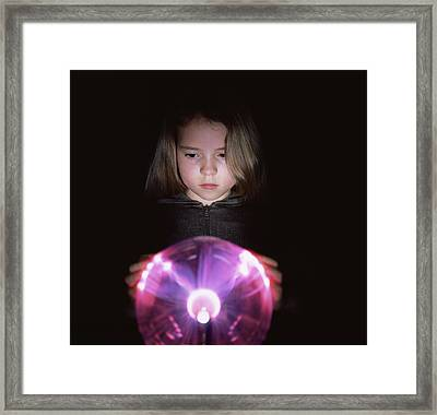 Girl Touching A Plasma Globe Framed Print by Kevin Curtis