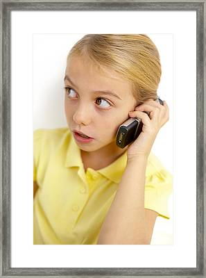 Girl Using Mobile Phone Framed Print