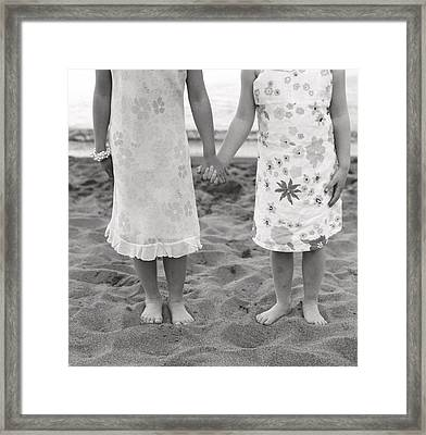 Girls Holding Hand On Beach Framed Print by Michelle Quance