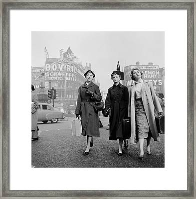 Girls In Town Framed Print by Harry Kerr