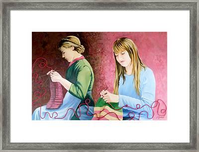 Girls Knitting Framed Print