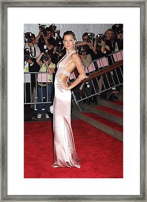 Gisele Bundchen Wearing A Versace Gown Framed Print by Everett