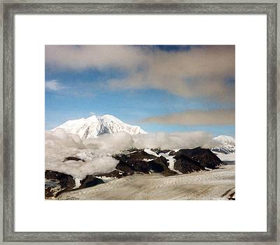 Glacier In The Clouds Framed Print