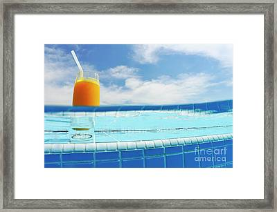 Glass Of Orange Juice On Pool Ledge Framed Print by Sami Sarkis