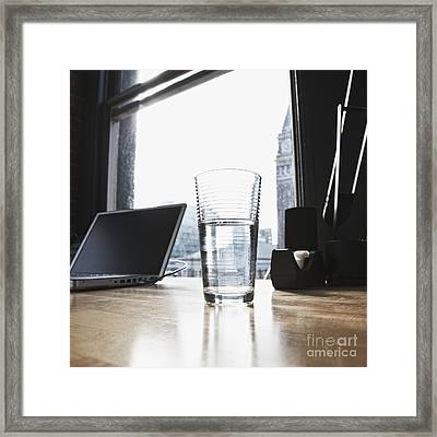 Glass Of Water And Laptop On A Desk Framed Print