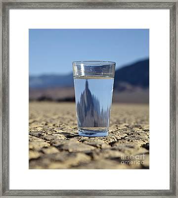 Glass Of Water In Desert Framed Print by David Buffington
