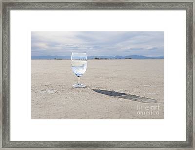 Glass Of Water On Dried Mud Framed Print