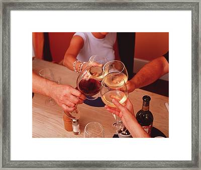 Glasses Raised In Toast Framed Print by Tony Mcconnell