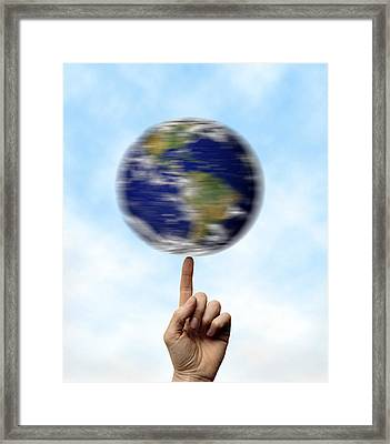 Globe Spinning On A Finger Framed Print by Cordelia Molloy