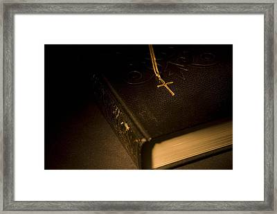 Gold Cross Pendant Resting On A Book Framed Print