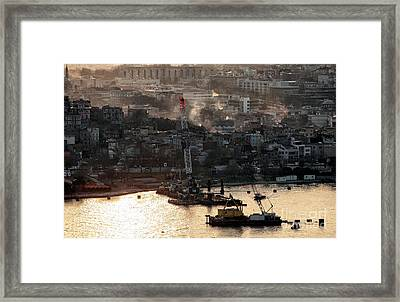 Golden Haze In Istanbul Framed Print by John Rizzuto