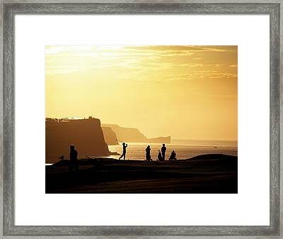 Golf Players Silhouetted In Front Framed Print by Chris Hill