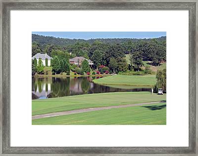 Golfer At Lake  Framed Print by Susan Leggett