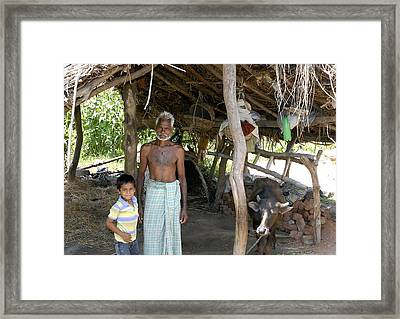 Grand Father With Grand Son Framed Print by Johnson Moya