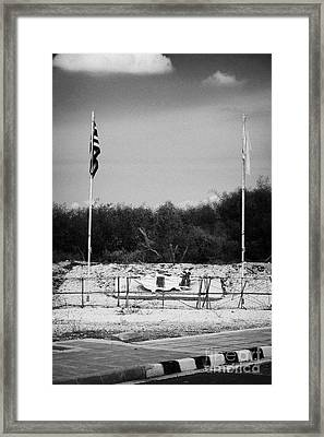 greek cypriot army memorial sign at the UN buffer zone in the green line dividing cyprus Framed Print by Joe Fox