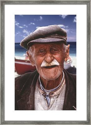 Greek Fisherman Framed Print by Ron Schwager