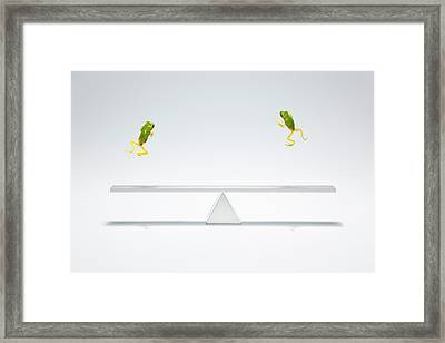 Green Frog Flying Over The  Seesaw Framed Print by Yuji Sakai
