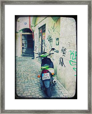Green Vespa In Prague Framed Print by Linda Woods