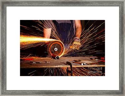 Grinder In Action Framed Print by Gualtiero Boffi