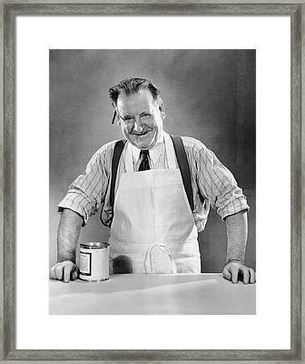 Grocery Store Salesman W/can On Counter Framed Print by George Marks