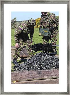 Guardsmen Pick Up Empty Brass Casings Framed Print by Andrew Chittock