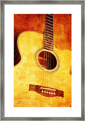 Guitar On Old  Wall Framed Print