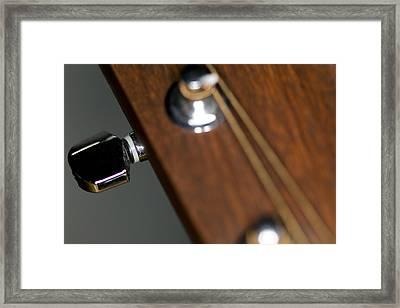 Guitar Tension Framed Print by C Ribet
